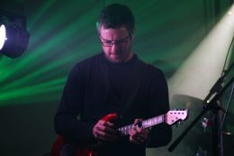 "Guitarist Darren Dean has a background in electric folk music. His previous band was ""The PepperMints"" who had minor hits with ""Ride My Taxi"" and ""Three Little Words (You Big Pig)"". He left them to join Moonshot in 2011."